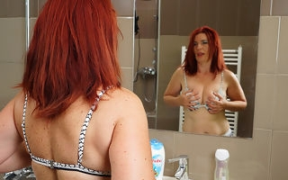 Sizzling redhead housewife acquiring himself off