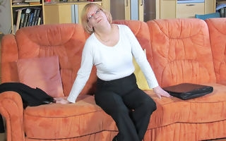Mature German slattern masturbating on transmitted to couch